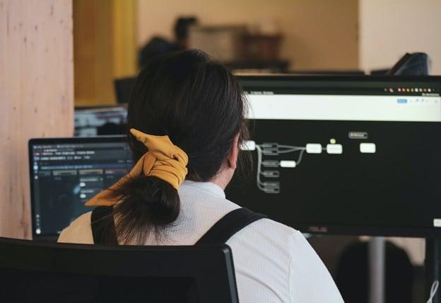 What software development challenges does DevOps solve?